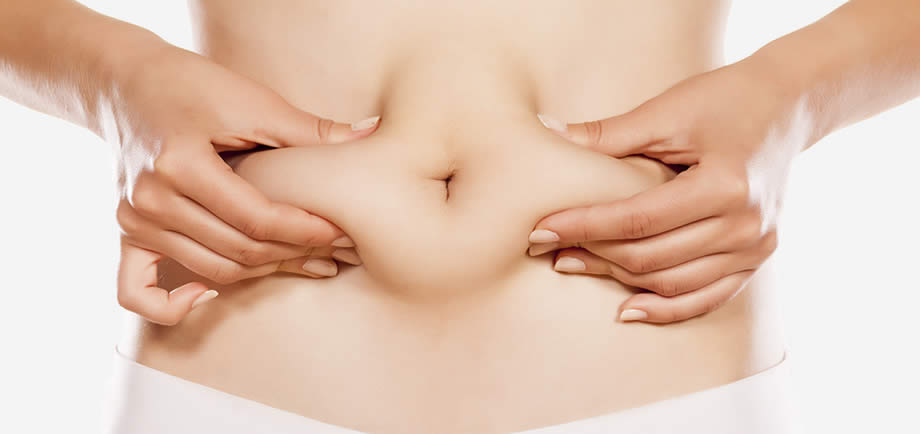 woman squeezing abdominal fat